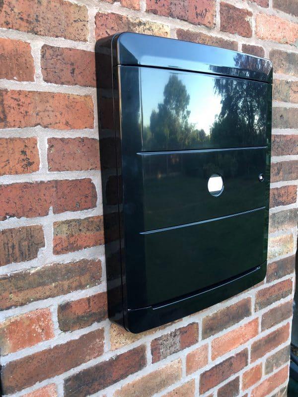 Black Overbox on brick